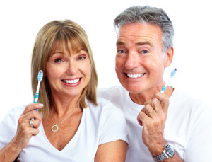 smiling-couple-with-toothbrushes
